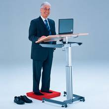 Stand or sit in front of an inclined or a flat work surface.